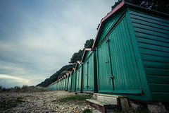 Green beach huts (DamianRees) Tags: uk christchurch green beach seaside shed wideangle hut dorset beachhut bournemouth beachhuts 1022mm 10mm superwide avonbeach