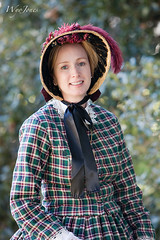 Southern Maiden (wyojones) Tags: woman cute girl beautiful smile hat lady hair eyes pretty texas dress expression lace blueeyes redhead hempstead bow earrings lovely plaid youngwoman strawberryblonde bonnett perioddress prairieview wallercounty civilwarweekend liendoplantation wyojones