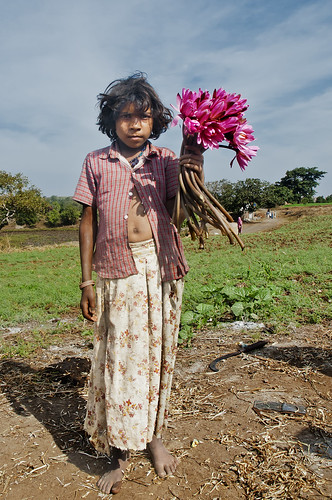 The Girl in Toranmal of stoic countenace who also sells lotus flowers
