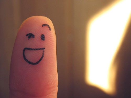 finger with face drawn on