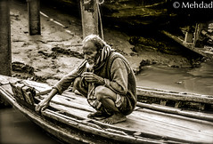 Bewildered Fate (emdeelogy) Tags: poverty life old portrait man river boat is cigarette smoke it bangladesh uncertainty
