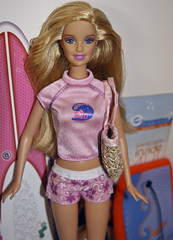 Blonde Barbie (DollyWorld) Tags: pink portrait beach girl beautiful beauty smile swim pose toy doll pretty sweet barbie cutie plastic blonde shorts sweetheart boardshorts swimmers dolly favourite mattel swimwear collector beachy beachbag togs boardies rashie