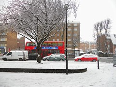 Winter's winning ways. (davidezartz) Tags: street uk greatbritain pink blue windows winter friends red england sky people brown white snow black bus tree green london cars lamp yellow buildings grey march nikon pavement weekend branches busstop roofs lampost covers advertisements ways winters bollard winning londonbus coldest 50years s4000 coth supershot nikonstunninggallery abigfave diamondclassphotographer flickrdiamond citrit flickrestrellas quarzoespecial saariysqualitypictures coth5 mygearandme nikons4000 nikoncoolpixs4000 flickrstruereflectionlevel1 rememberthatmomentlevel1 vigilantphotographersunite vpu2 vpu3 vpu4 vpu5 vpu6 vpu7 vpu8 vpu9 vpu10 winterswinningways