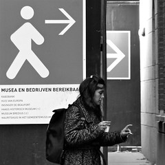 Time for coffee and a cigarette (Akbar Simonse) Tags: bw woman holland blancoynegro coffee girl square zwartwit cigarette candid nederland streetphotography backpack smoker sigaret straat roken koffie straatfotografie dedoka akbarsimonse
