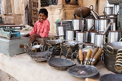 Kitchenware shopkeeper - Pushkar Fair - 21/11/2012 (www.richardisaac.co.uk) Tags: travel india shop photo highresolution image picture culture stall pic hires pots photograph pushkar rajasthan pans kitchenware highres shopkeeper gbr camelfair pushkarfair hiresolution