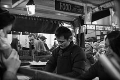Serving hungry customers (ebenette) Tags: leica blackandwhite london photography m8 streetfood summilux35mmasph ebenette