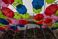 Colours Above (V Photography and Art) Tags: above blue red green window glass wall reflections colours reflected lilac installation hanging colourful suspended umbrellas brickwork londoncalling flickrfriday