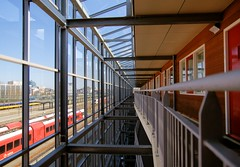 In or Out? (Hindrik S) Tags: flat apartement gallery galerij station train arriva ns red white ljouwert leeuwarden wijnhorsterstraat emplacement architecture line lines perspective vanishingpoint a300 alpha300 blue cpf light liwwadden lucht loft sky tamron1750 tamron sonyalpha tamronspaf1750mmf28xrdiiildasphericalif α300 17mm f28 14000 sonyphotographing amount