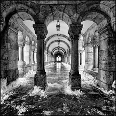 Hungary - Budapest - Fishermans Bastion Colonnade 01 sq mono (Darrell Godliman) Tags: winter blackandwhite bw snow ice monochrome architecture mono squares framed gothic budapest columns perspective symmetry squareformat framing fortification neogothic fortifications sq pest colonade collonade fishermansbastion bsquare halszbstya neoromanesque hungarybudapestfishermansbastioncolonnade01sqmonodsc2062
