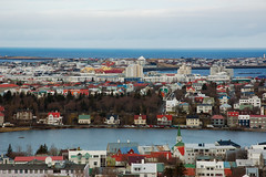 in the Bay of Smokes (panichie) Tags: ocean city travel houses sea church colors iceland europe view rooftops hallgrimskirkja reykjavik roofs reykjavk hallgrmskirkja