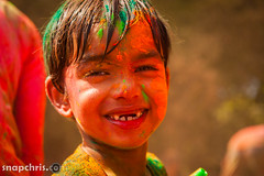 small boy smiles at Asha Stanford Holi Festival 2013 (tibchris) Tags: festival fun paint indian smiles stanford asha holi 2013 snapchris