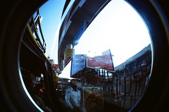 Santa Cruz Streetlife (raspberry dolly) Tags: india film lomography fisheye mumbai lomofisheye