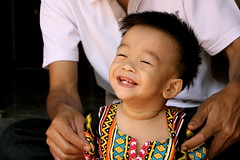 Laughing in Thailand (ro_chelle) Tags: boy thailand temple kid asia southeastasia child newyear chiangmai tradition traditionaldress