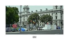 270611 (ALTBAUT) Tags: strike london white dark building random blunt colorful flag latinamerica streetlight manifesto