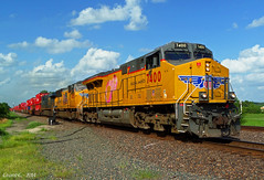 "Westbound Intermodal in Bonner Springs, KS (""Righteous"" Grant G.) Tags: union pacific railway railroad locomotive pink ribbon unit susan g komen kansas intermodal train trains west westbound"