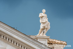 Rome, Italy- Close up of a Roman sculpture on the exterior of (New) St. Peter's Basilica located in Vatican City (an enclave of Rome). Begun by Pope Julius II, St. Peter's is dedicated to the Apostle Peter and is built in the form of a Latin cross filled (Remsberg Photos) Tags: europe italy rome ancient ancientcivilization roman architecture buitstructure tourist sightseeing photography history historical internationallandmark capitolcity romaprovince ancientrome art church religion basilica stpetersbasilica newstpetersbasilica vaticancity pope popejuliusii apostle pilgrimage michelangelo peter renaissance baroque statue sculpture ita