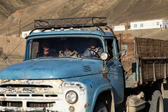 Blue Truck Murghob Pamir Highway Tajikistan Central Asia (eriagn) Tags: asia centralasia tajikistan murghab pamir mountainous mountains semiarid highaltitude herding herd yaks family nomads seminomadic livestock road dirtroad 4wd horse bicycle geofgraphy geology grass river eriagn ngairelawson ngairehart travel photography murghob summer pamirmountains truck bluetruck men cigarette laughing smiling shadow transport peoplemover cartage