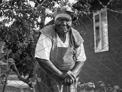 the old lady from zambia // mamelodi, south africa (pamela ross) Tags: old portrait people garden southafrica town streetphotography olympus aged pretoria township wrinkels streetpics mamelodi pamelaross penepl5