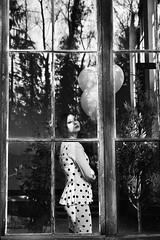 faces (AntjeEgbert) Tags: light bw woman sunlight window fashion balloons licht shadows dress fenster sw frau dots mode ballons schatten spiegelung glas kleid punkte sonnenlicht schwarzweis