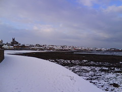 View of Dunbar from the esplanade: winter (tumpshy) Tags: winter snow beach scotland esplanade seafront dunbar wintersnow broodingsky eastbeach snowonthebeach crispwintersday winter2010 dunbarbeach tumpshy