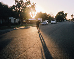 push (kigbot) Tags: street sunset shadow arizona film phoenix silhouette 35mm golden skateboarding hour bessar2 fujisuperiaxtra400 colorskopar35mmf25