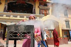 The Offering (Aml's) Tags: street travel nepal woman temple asia bell smoke prayer mystical kathmandu boudhanath reportage