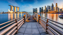 Marinapolis [Explored] (Scintt) Tags: city travel bridge sunset sky urban panorama tourism water lines skyline museum architecture modern clouds marina buildings reflections way point lights evening bay pier hall twilight singapore mood cityscape place stitch dusk pano jetty towers perspective structures dramatic calm reservoir sands exploration vanishing lead railings epic leading raffles shenton scintillation artscience scintt