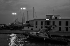 Marzo 2013 (nuamba) Tags: sea blackandwhite bw coastguard reflection monochrome night reflex raft bigcalm baia nikond3200 guardiacostiera nuamba