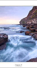 Canyon X (John_Armytage) Tags: clouds sunrise dawn rocks australia textures blowhole nsw headland northernbeaches warriewood slowwater canyonx warriewoodblowhole johnarmytage wwwjohnarmytagephotohgraphycom