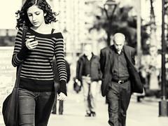 checking e-mail (Gerard Koopen) Tags: life street blackandwhite bw blancoynegro girl monochrome turkey photography nikon fotografie candid stripes streetphotography antalya 70200 turkije d800 straatfotografie 2013 checkingemail
