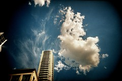 cloudfire #1 (mugley) Tags: city blue sky urban colour film architecture modern clouds 35mm buildings apartments cityscape afternoon skyscrapers kodak towers grain australia melbourne wideangle victoria scan crappycam negative balconies epson boxes cbd 135 brady vignetting kodakgold100 urbanlandscape c41 22mm latrobest gold100 v700 cloudage keystoning vivitarultrawideandslim republictower wideslim eximus labanque eximuswideandslim lawank