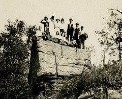 A Small Crowd on a Big Rock (Cropped) (Alan Mays) Tags: old trees girls cute men boys portraits vintage children women funny rocks humorous photos antique humor hats ephemera hills photographs postcards amusing groups rockformations foundphotos hillsides rppc realphotopostcards