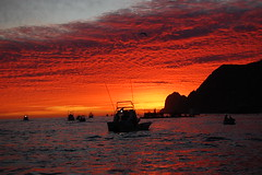 Morning's glory (The Clam Man) Tags: ocean sunset sky reflection water colors clouds mexico boats evening cabosanlucas lowsun settingsun