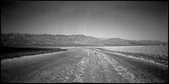 Badwater Basin (joshuammulligan) Tags: california blackandwhite bw 120 belair childhood analog mediumformat point landscape lomo lomography fuji child desert salt playa mojave deathvalley neopan 100 analogue lowest 58mm epic monumental acros badwater saltflat badwaterbasin childrunning filmphotography 6x12