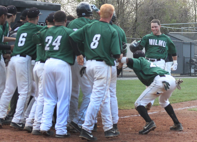 Wilmington University hitter Brandon Payne (28) comes home after scoring the game winning three-run walk-off home run during their NCAA baseball game against Kutztown University at Wilson Field in New Castle, Del., on Thursday April, 18th 2013. Photo Credit: Shelly Parks.