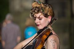 Faith - 1 (Alastair 2008) Tags: fiddle female street entertainer bow piercing strap blacktop
