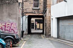 No Left Turn (m.o.n.o.c.h.r.o.m.e.) Tags: archway path scotland yellowline garage graffiti garagedoor vandalism cobbles breadstreetlane door edinburgh sign signpost noleftturn