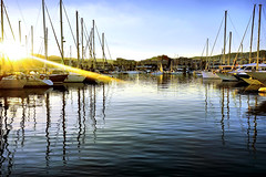 When the sun decides to paint (Fnikos) Tags: port sun light sky skyline serene cloud gold golden sea city water waterfront reflection boat vehicle outdoor