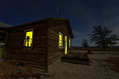 dust bowl. 2015. (eyetwist) Tags: eyetwistkevinballuff eyetwist night abandoned derelict mojavedesert antelopevalley nikon nikond7000 d7000 nikkor capturenx2 1024mmf3545g fullmoon desert arid dark longexposure moonlight moonlit npy nocturne highdesert mojave california moon long exposure wideangle wide light painting lightpainting roadside america tumbleweeds flashlight horizon forgotten ruin lancaster decay house shack wood crumbling broken architecture peeling faded weathered clouds stars urbex exploring alfalfa farmhouse farm sky clapboard saturated av antelope valley yellow homestead tree dead patina