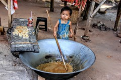 Who's the biggest of all!!! (cattan2011) Tags: phnompenh village cambodia travelblogger traveltuesday travel streetpics streetphotography child stall portrait