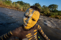 portrait of a child with his face painted the Surma tribe on the river Kibish (anthony pappone photography) Tags: africa travel boy portrait sky baby white black art face barn canon river painting landscape photography facepainting eyes paint artist foto faces image expression retrato african painted fiume culture clay cielo tribes afrika omovalley ethiopia ritratto surma reportage photograher afrique bambino faccia eastafrica phototravel suri facepainted etiopia etnic whiteclay 非洲 etnico ethiopie etiope etnia argilla アフリカ loweromovalley etnica etnologia afryka childrentravel losniños etiopija portraitsofchildren 아프리카 etiopien kibish africantribe африка etiopi tulgit अफ्रीका lowervalleyomo kibishriver