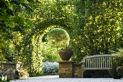 GATEWAY to PARADISE (The Open Wall (GrantE)) Tags: flowers light canon bench hedge gateway archway botanicalg