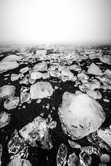 Ice and sand (Gujn Ott) Tags: sea sky bw cloud white black ice beach nature water fog landscape sand rocks waves gravel sjr nttra jkulsrln vatn sk svart himinn fjara sandur klettar landslag oka klaki hvt ldur ml