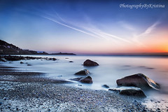 Morning In Killiney (PhotographyByKristina (400,000 + views)) Tags: ocean pink ireland light sunset sky cloud lighthouse seascape colour reflection art beach nature beautiful beauty rock stone clouds sunrise reflections landscape photography dawn golden coast seaside movement sand scenery rocks moody colours darkness image stones gorgeous horizon perspective creative scenic adorable wave scene professional clear getty dreamy ripples colourful moment capture wicklow dalkey gcc gettyimages nationalgeographic killiney countywicklow pebles sciene dalkeyisland digitalcameraclub 2013 beautifulexpression dreaminess theperfectphotographer nikkor2470 saariysqualitypictures gettyimagesireland greystonescameraclub photographybykristina gettyireland