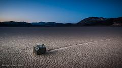 Power Slide. (JM Lobert) Tags: california longexposure nightphotography lightpainting stone dark lowlight desert mud deathvalley cracks startrails racetrackplaya nightlandscape northstar sailingrocks