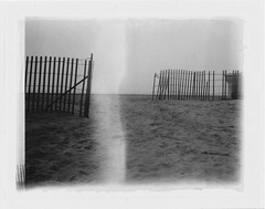Gates to the End (c_kreature) Tags: california bw film beach fence polaroid wooden sand orangecounty peel oc huntingtonbeach hb apart huntingtonharbor peelapart filmsnotdead peelapartfilm landcamera104 filmwins fujifilm3000b benjaminsoto polaroid104landcamera canoscan9000f believeinfilm