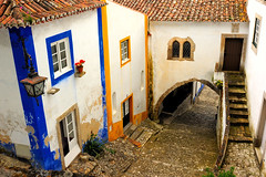 Obidos, Portugal (Sunsword & Moonsabre) Tags: street door city flowers house portugal window architecture stairs photography spring nikon colours view hiking decay tunnel roofs nikkor escaleras 35f2 frameit d700 nikonfx frameitlevel3 frameitlevel2 frameitlevel4 frameitlevel5 frameitlevel6 frameitlevel7 frameitlevel8 frameitlevel9 frameitlevel10