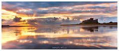 Bamburgh Castle Panorama (Sebastian Kraus) Tags: trees light sunset red sun green castle water grass rain yellow clouds sunrise scotland highlands rocks edinburgh view sebastian stones visit workshop loch bamburgh kraus lochan visitscotland takeaview sebastianito
