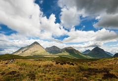 Red Cuillins (Philipp Klinger Photography) Tags: ocean uk greatbritain trip blue light shadow red sea vacation sky orange cloud sun mountain holiday mountains skye green nature grass yellow clouds scott landscape island scotland flora nikon europa europe isleofskye unitedkingdom hiking