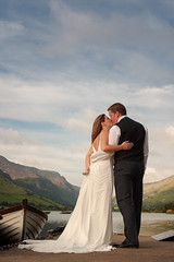 Jackie & Tim (Howie Mudge LRPS BPE1*) Tags: wedding portrait clouds canon groom bride boat scenery kiss kissing couple view naturallight 10d talyllynlake 2485mm ©howiemudge2013